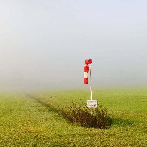 Fine Art Fotografie Allgäu Windsack Nebel Flugplatz Immenstadt Kees van Surksum Fotografie on nstagram